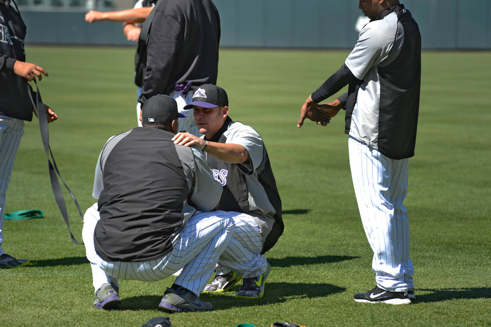 . Rafael Betancourt (R) talks with Juan Nicasio after an argument broke out between Nicasio and Escolona during stretching exercises. Manager Walt Weiss talked with both pitchers after practice. The Colorado Rockies held an open practice for the fans April 4, 2013 at Coors Field. (Photo By John Leyba/The Denver Post)