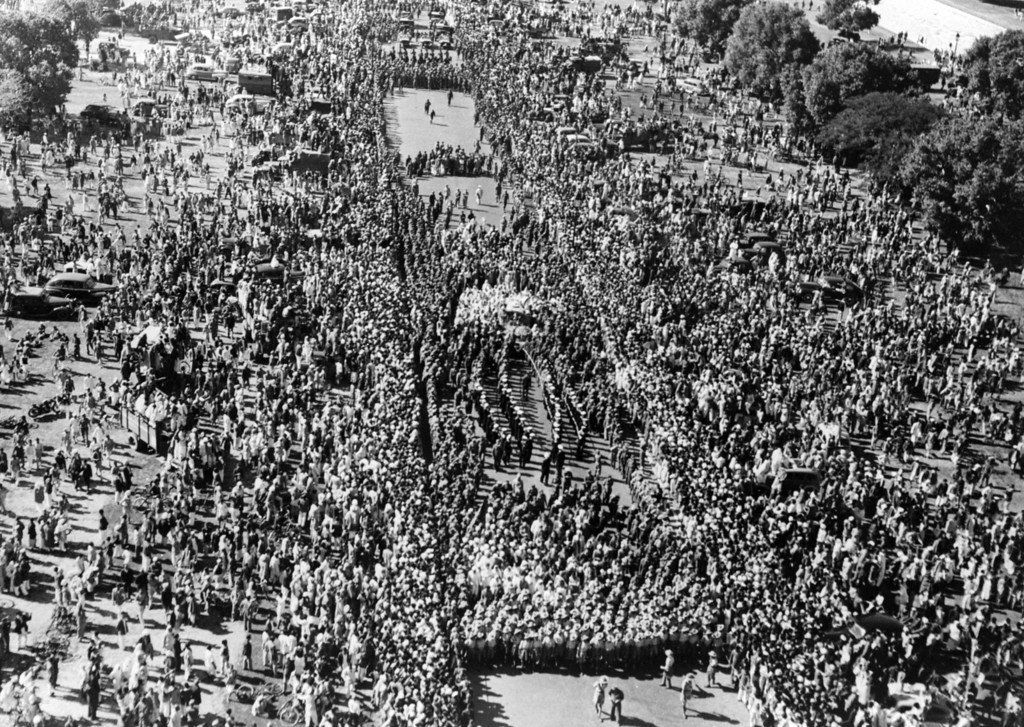 . A crowd watching the funeral procession of Indian statesman and advocate of non-violence Mahatma Gandhi (Mohandas Karamchand Gandhi) who was assassinated in Delhi, 1948.  (Photo by Fox Photos/Getty Images)