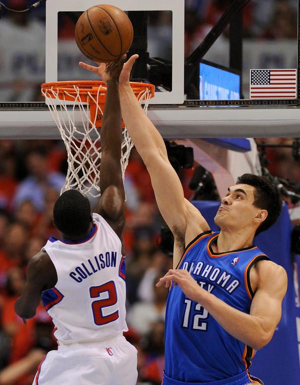 . Thunder\'s Steven Adams blocks a shot by Darren Collison. (Photo by Michael Owen Baker/Los Angeles Daily News)