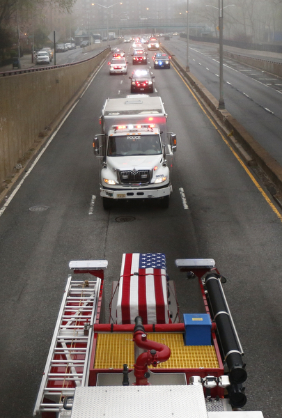 . An American flag is draped over a casket of the unidentified remains of victims of the Sept. 11, 2001 attacks as they are returned to the World Trade Center site, Saturday, May 10, 2014, in New York. The remains were moved from the Office of the Chief Medical Examiner on Manhattan\'s East Side at dawn Saturday to an underground repository in the same building as the National September 11 Memorial Museum. (AP Photo/Julio Cortez)
