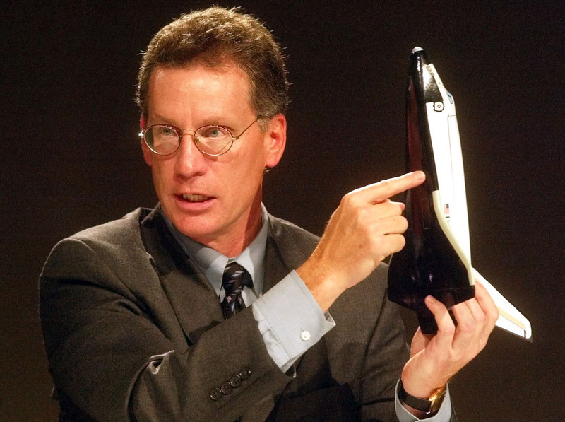 . Ron Dittemore, space shuttle program manager, makes remarks while holding a model of the shuttle during a press conference, at the Johnson Space Center, Monday, Feb. 2, 2003, in Houston. While Columbia was still in orbit, NASAs best and brightest minds analyzed the potential damage done to its thermal tiles by a piece of debris during liftoff and concluded that the flight was in no danger, agency officials said Monday. (AP Photo/Rick Bowmer)