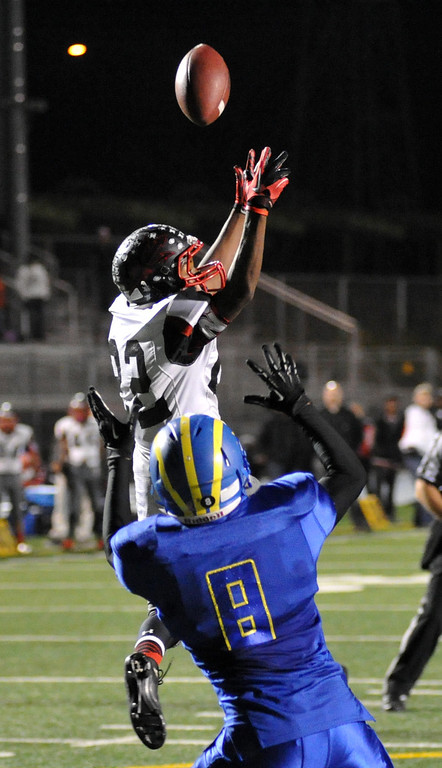 . Pomona wide receiver Desmond Bobo (#22) catches a pass for a touchdown as they play San Dimas in their Valley Vista League football game at San Dimas High School on November 8, 2013. San Dimas defeated Pomona 49-6. (San Gabriel Valley Tribune/Staff Photo by Keith Durflinger)