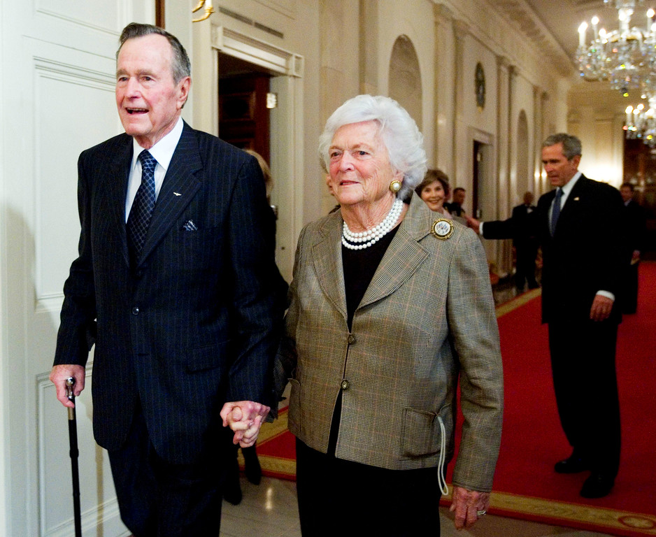 . Former President George H. W. Bush, left, walks with his wife, former first lady Barbara Bush, followed by their son, President George W. Bush, and his wife first lady Laura Bush, to a reception in honor of the Points of Light Institute, Wednesday, Jan. 7, 2009, in the East Room at the White House in Washington. (AP Photo/Manuel Balce Ceneta)