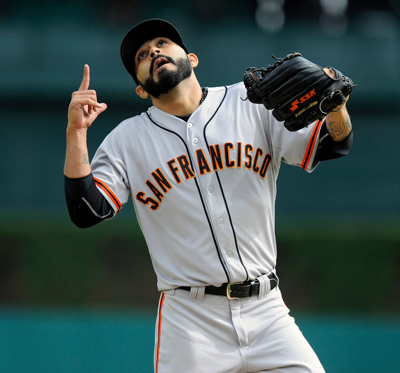 . San Francisco Giants pitcher Sergio Romo celebrates after getting the third out against the Detroit Tigers in the eighth inning of a baseball game Saturday, Sept. 6, 2014, in Detroit, Mich.  The Giants won 5-4.  (AP Photo/Jose Juarez)
