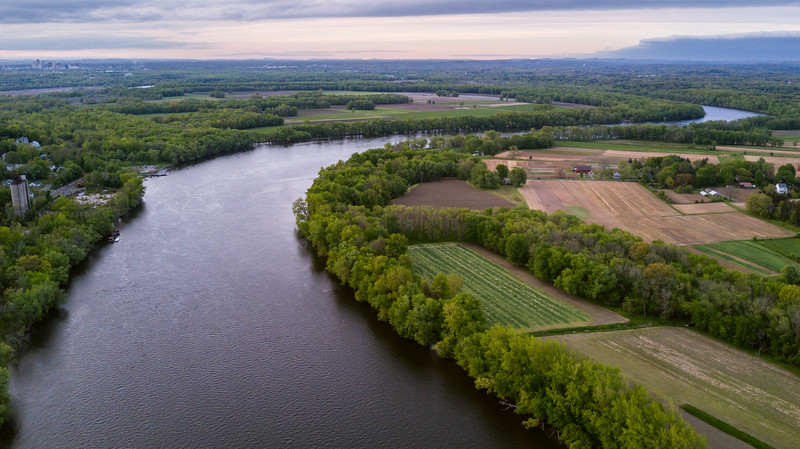 Aerial drone view over the Connecticut River looking north towards Hartford, CT in the background and Glastonbury farmland in the foreground
