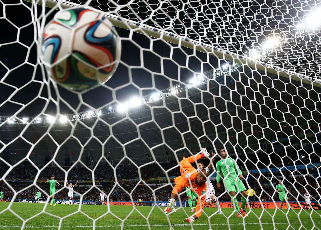 . Rais M\'Bolhi of Algeria fails to save a shot by Andre Schuerrle of Germany (not pictured) for Germany\'s first goal in extra time during the 2014 FIFA World Cup Brazil Round of 16 match between Germany and Algeria at Estadio Beira-Rio on June 30, 2014 in Porto Alegre, Brazil.  (Photo by Julian Finney/Getty Images)