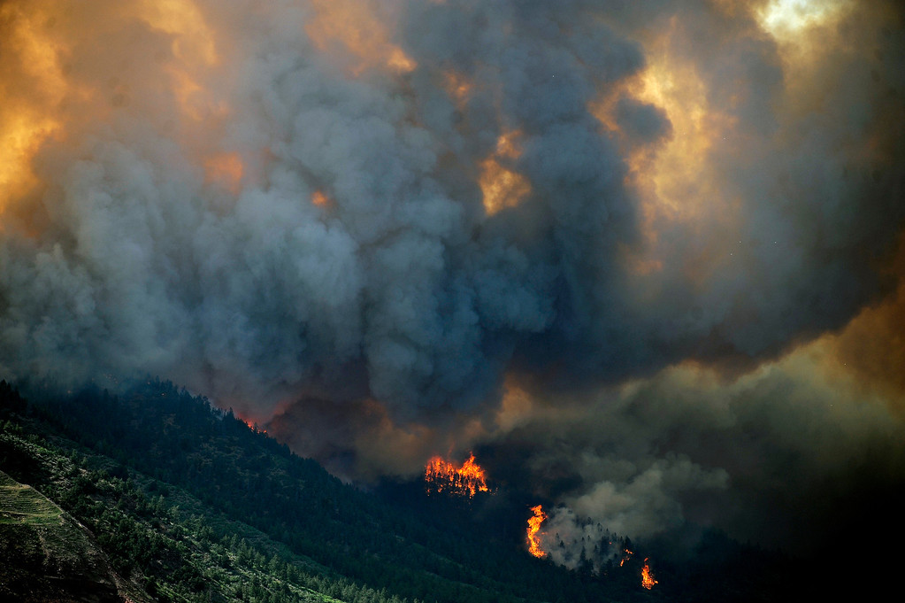 . The Waldo Canyon fire continues to burn northwest of Manitou Springs, Colorado, June 26th, 2012. Helen H. Richardson, The Denver Post