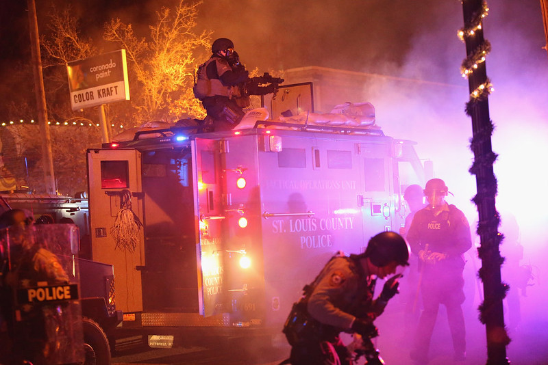 . Police confront protestors after rioting broke out following the grand jury announcement in the Michael Brown case on November 24, 2014 in Ferguson, Missouri. Ferguson has been struggling to return to normal after Brown, an 18-year-old black man, was killed by Darren Wilson, a white Ferguson police officer, on August 9. His death has sparked months of sometimes violent protests in Ferguson. A grand jury today declined to indict officer Wison.  (Photo by Scott Olson/Getty Images)