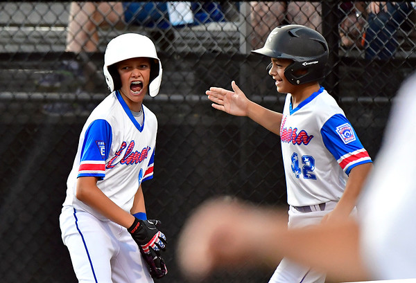 8/10/2019 Mike Orazzi | Staff New Jersey Elmora Youth Little League's Sal Garcia (1) and J.R. Rosado (42) after scoring during Saturday's Mid Atlantic Final baseball game with New York at Breen Field in Bristol, Conn.