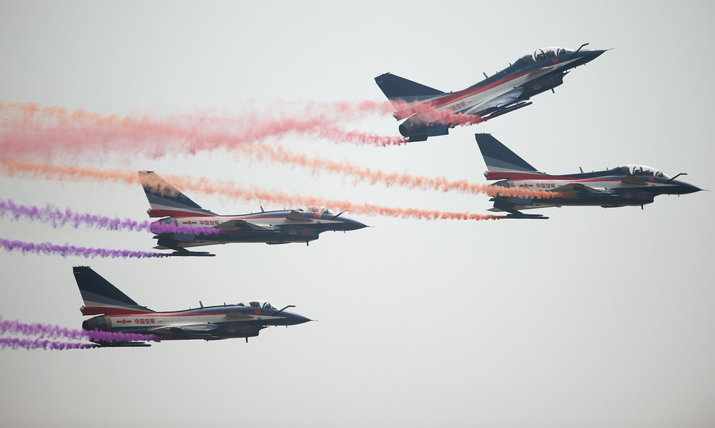 . J-10 fighter jets of the Bayi Aerobatic Team of PLA\'s (Peoples Liberation Army) Air Force perform at the Airshow China 2014 in Zhuhai, south China\'s Guangdong province on November 12, 2014.  The 10th Airshow China 2014 takes place from November 11 to 16.   AFP PHOTO / JOHANNES  EISELE/AFP/Getty Images