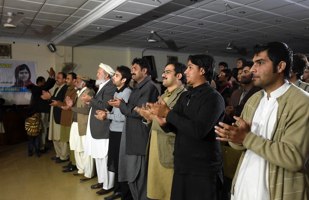 . Pakistan residents clap as they watch a live broadcast of the award ceremony of joint Nobel Peace Prize laureate, Malala Yousafzai at a school hall in her home town of Mingora, a district of Swat valley on December 10, 2014.  Hundreds of residents in Malala Yousfazai\'s hometown cheered as they watched their hero accept her Nobel Peace Prize on a giant TV, as Pakistan\'s Prime Minister promised the activist\'s dream for girls\' education would come true. AFP PHOTO / A MAJEEDA Majeed/AFP/Getty Images