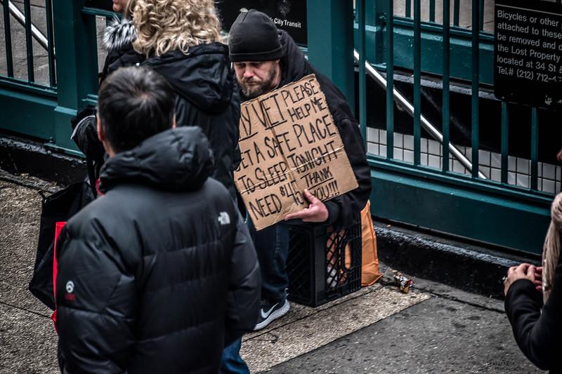Homeless vet passed by.jpg