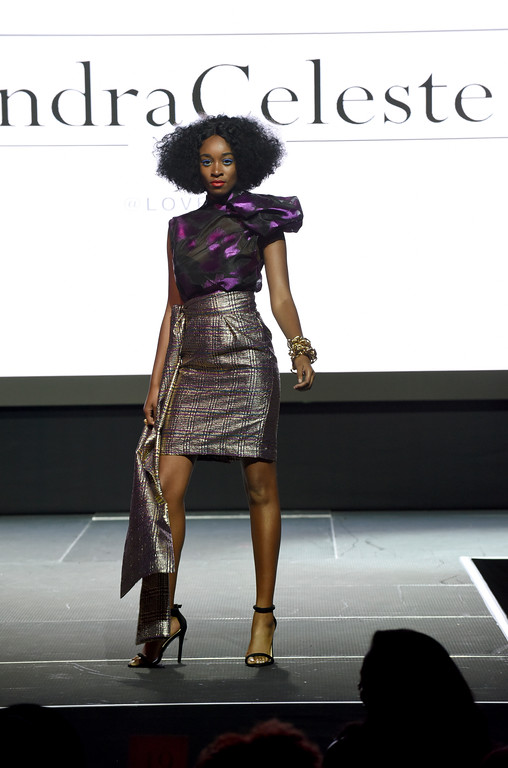 . The Undra Celeste collection is modeled at the Harlem Fashion Row show and awards ceremony before the start of New York Fashion Week, Tuesday, Sept. 4, 2018. (AP Photo/Diane Bondareff)