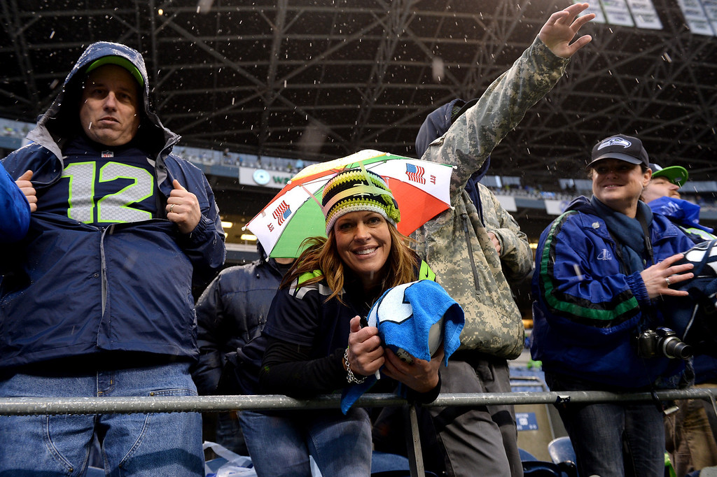 . SEATTLE, WA - JANUARY 11:  Michelle Baker poses from the stands before the Seattle Seahawks take on the New Orleans Saints in the NFC Divisional Playoff Game at CenturyLink Field on January 11, 2014 in Seattle, Washington.  (Photo by Harry How/Getty Images)