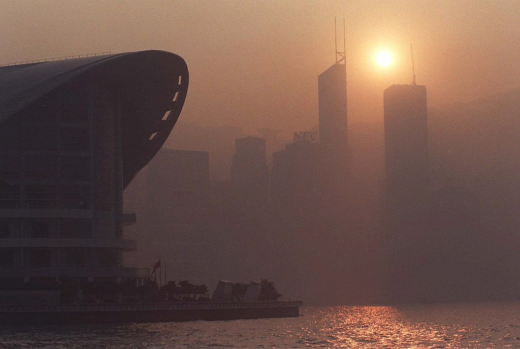 . Hong Kong harbor and the surrounding urban area is blanketed with smog on Tuesday, Jan. 19, 1999, with the pollution index reaching 118. When the index lies between 101 and 200, people in Hong Kong are advised to reduce exertion and outdoor activities. (AP Photo/Vincent Yu)