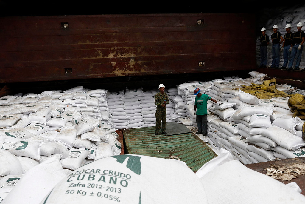 """. Worker stand on top of  bags labeled \""""Cuban Raw Sugar\"""" inside a North Korean flagged ship \""""Chong Chon Gang\"""" docked at the Manzanillo Container Terminal in Colon City July 16, 2013. REUTERS/Carlos Jasso"""