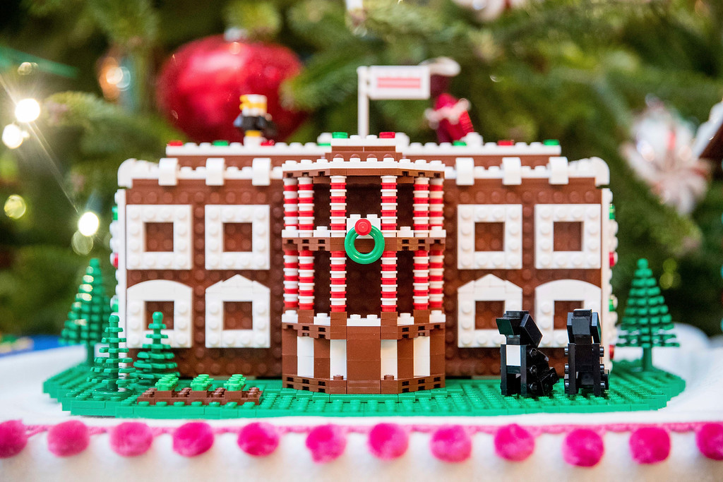 . The White House, is one of the fifty-six LEGO gingerbread houses, one for each state and territory, are displayed in the trees in the State Dinning Room at the White House during a preview of the 2016 holiday decor, Tuesday, Nov. 29, 2016, in Washington. Each of the LEGO gingerbread houses are a one-of-a-kind creation and feature colors, architecture styles and details that pay tribute to each state or territory. This house was made for the District of Columbia.  (AP Photo/Andrew Harnik)