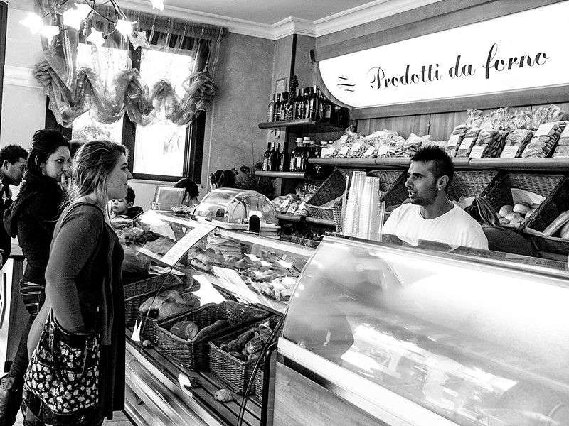 Jami Cakes picking up something delicious to go with the cheese she's going to buy outside at L'Angolo Della Focaccia, Velie...