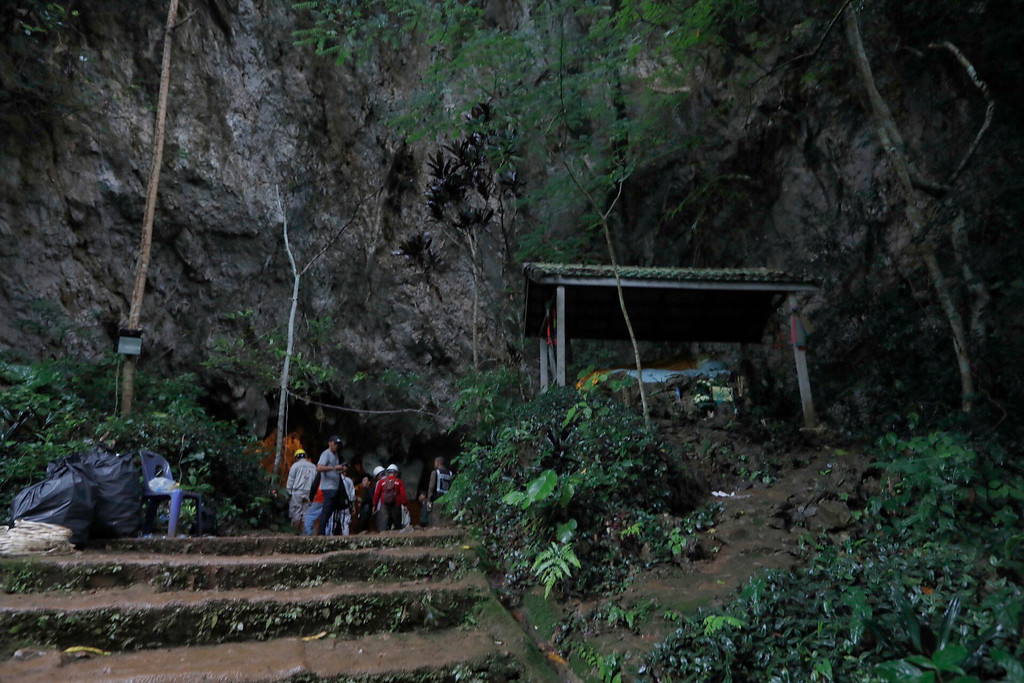 . Rescue teams gather at the entrance of a deep cave where a group of boys went missing in Chiang Rai, northern Thailand, Monday, June 25, 2018. Officials say multiple attempts to locate the 12 boys and their soccer coach missing in a flooded cave in northern Thailand for nearly two days have failed, but that they will keep trying. (Thai News Pix via AP)
