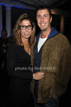 """Michelle Suna and screenwriter of """"Tower Heist"""" Bill Collage attend the openig night party of the Hamptons International Film Festival at East Hampton Point (October 13, 2011)"""