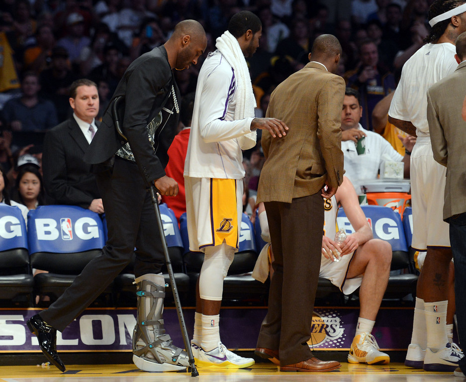 . Injured Laker Kobe Bryant walks on the court during game four of their NBA Western Conference playoffs against the Spurs at the Staples Center Saturday, April 28, 2013. The Spurs beat the Lakers 120-89. The Spurs beat the Lakers 103-82. (Hans Gutknecht/Staff Photographer)