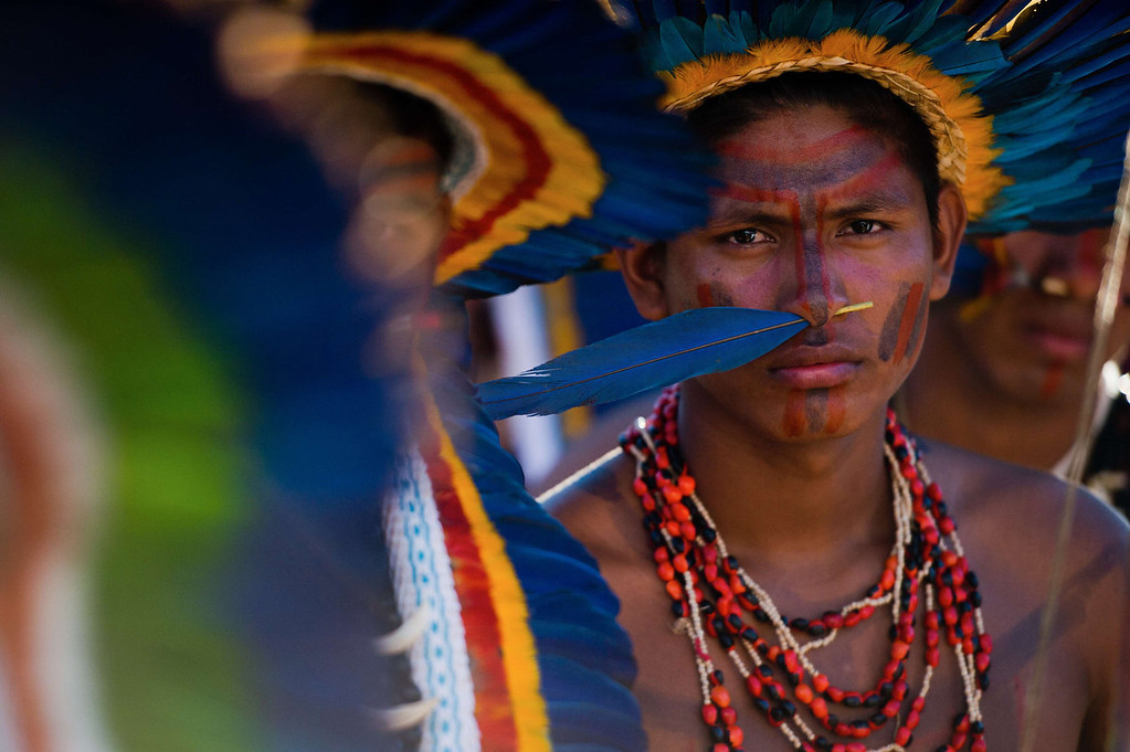 . Natives wait for the start of the opening ceremony of the International Games of Indigenous Peoples, in Cuiaba, state of Mato Grosso, on November 9, 2013. 48 Brazilian ethnic groups and indigenous representatives from 16 countries are taking part in the event which runs until November 16. AFP PHOTO / CHRISTOPHE SIMON