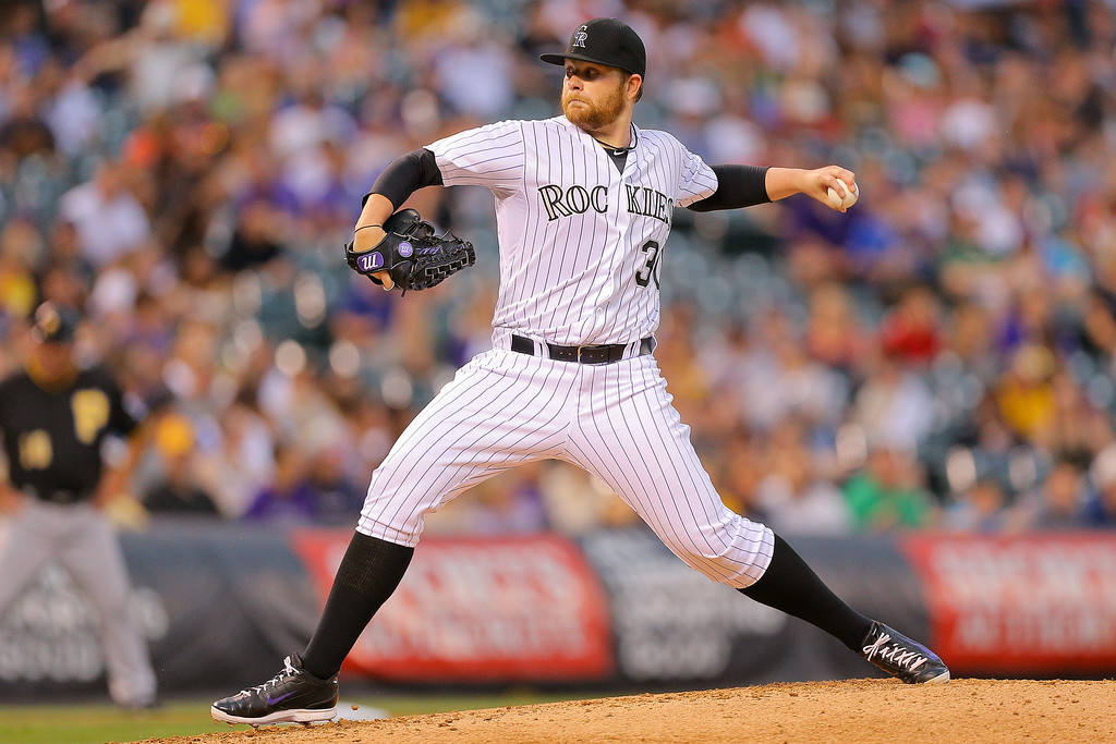 . Starting pitcher Brett Anderson #30 of the Colorado Rockies delivers to home plate during the third inning against the Pittsburgh Pirates at Coors Field on July 25, 2014 in Denver, Colorado. (Photo by Justin Edmonds/Getty Images)