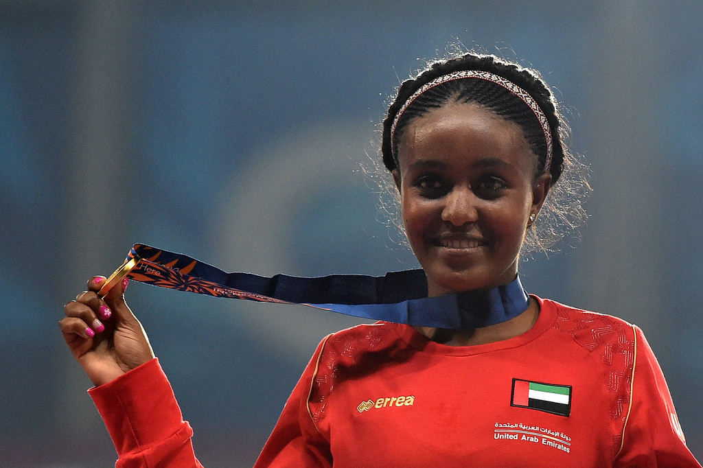 . Gold medallist United Arab Emirates\'s Alia Mohammed Saeed Mohammed poses with her medal on the podium during the victory ceremony for the women\'s 10,000m athletics event during the 17th Asian Games at the Incheon Asiad Main Stadium in Incheon on September 27, 2014.  PHILIPPE LOPEZ/AFP/Getty Images