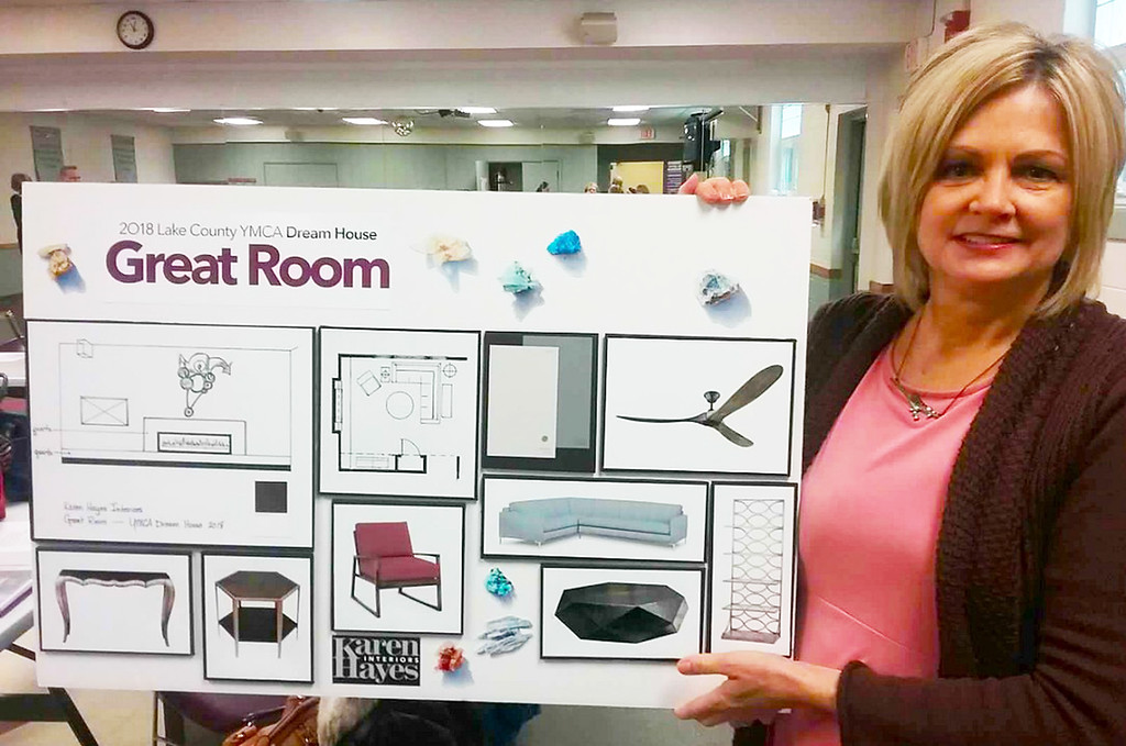 . Designer Carolyn Rigo of Karen Hayes Interiors in Willoughby presents elements to be used in the Great Room of the 2018 Lake County YMCA Dream House being built in Mentor.  {Jean Bonchak For The News-Herald}