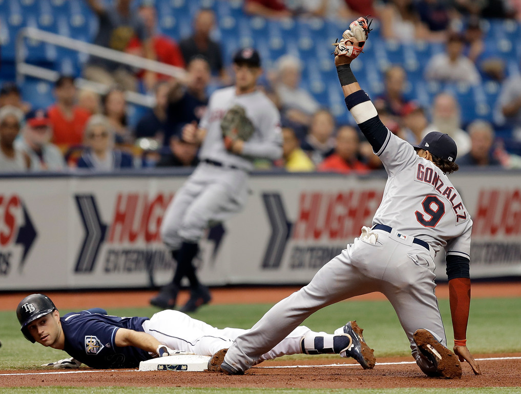 . Tampa Bay Rays\' Brandon Lowe slides into third base with a triple ahead of the tag by Cleveland Indians\' Erik Gonzalez (9) during the fourth inning of a baseball game Wednesday, Sept. 12, 2018, in St. Petersburg, Fla. (AP Photo/Chris O\'Meara)
