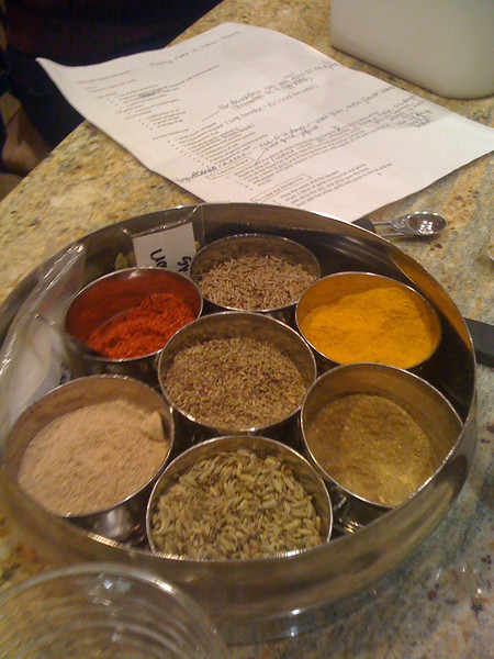The spices that Mary Irene bought in India from her chef Shashi. The weird ones: the bright-red chili powder, the oregano seeds in the middle, and the mango powder, just below the chili powder.