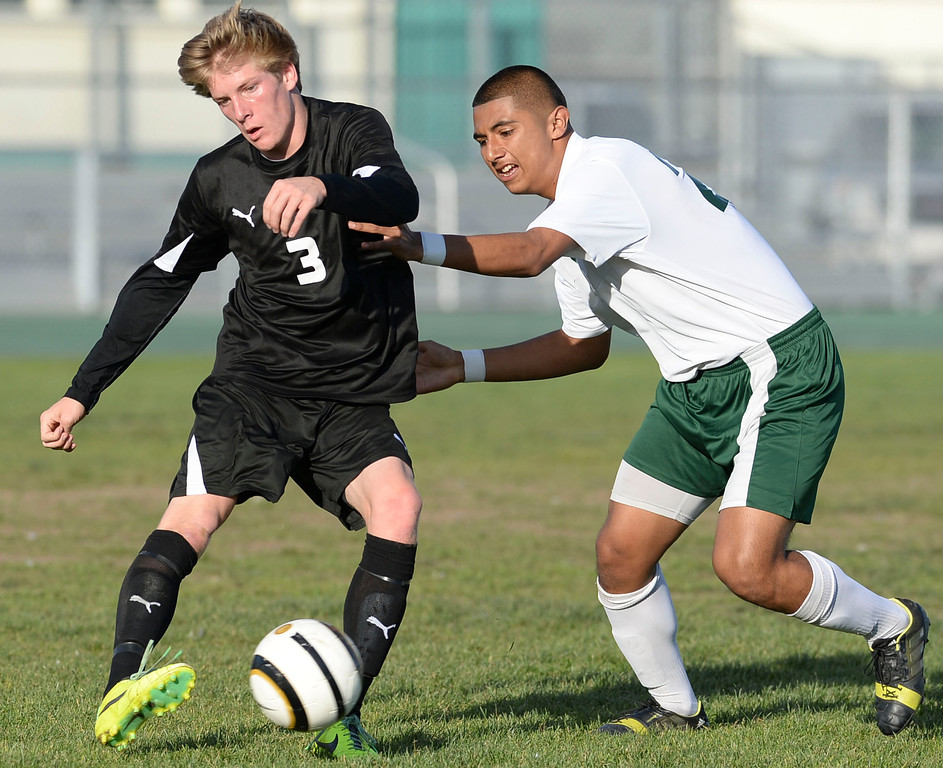 . Narbonne\'s Andrew Perez (23) defends against San Pedro\'s Patrick Schultz (3) in a Marine League boys soccer game Wednesday, February 12, 2014, Harbor City, CA.  Narbonne won 2-0 and seals the league title. Photo by Steve McCrank/Daily Breeze