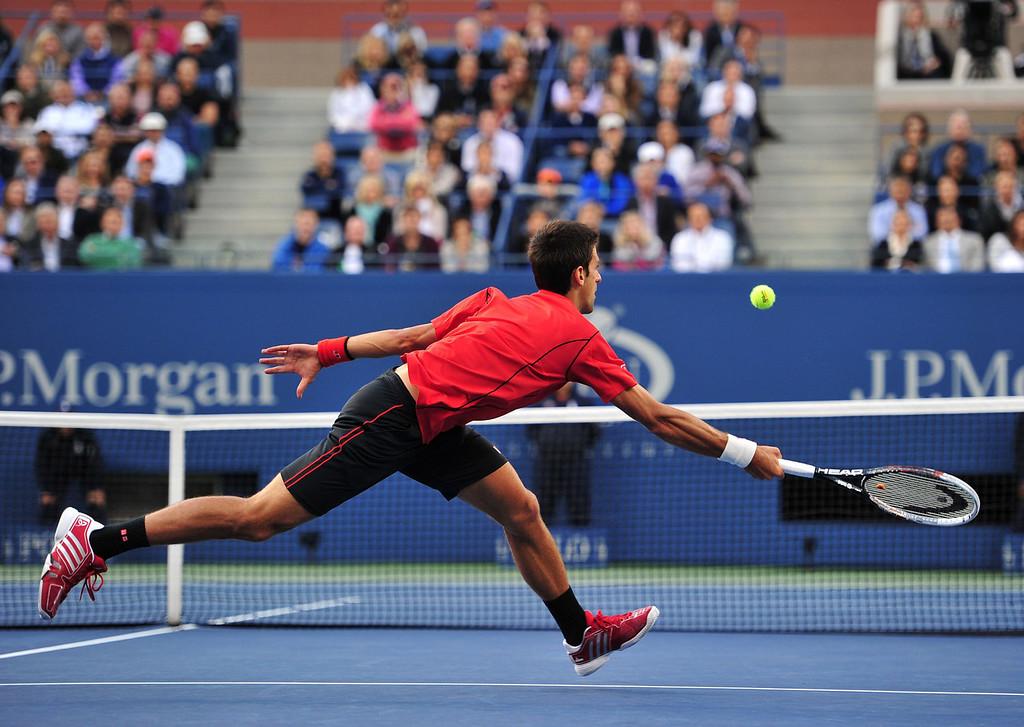 . Novak Djokovic of Serbia returns a shot to Rafael Nadal of Spain during their 2013 US Open men\'s singles final match at the USTA Billie Jean King National Tennis Center September 9, 2013 in New York.   STAN HONDA/AFP/Getty Images