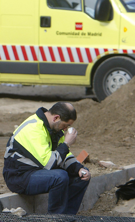 . A rescue worker wipes his eyes after a train exploded at the Atocha train station in Madrid 11 March 2004. At least 173 people were killed and some 600 injured early 11 March 2004 in near-simultaneous explosions on three trains in Madrid at the height of morning commuter traffic, the Spanish interior ministry said. In what appeared to be a deliberate attack staged only 72 hours ahead of Spanish general elections, the blasts went off on a long-distance high-speed carrier and two suburban trains packed with commuters. PIERRE-PHILIPPE MARCOU/AFP/Getty Images