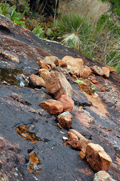 Rocks marking the trail.