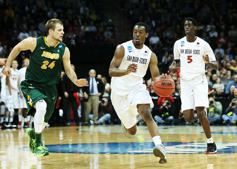 . Xavier Thames #2 of the San Diego State Aztecs drives against Taylor Braun #24 of the North Dakota State Bison in the first half during the Third Round of the 2014 NCAA Basketball Tournament at Spokane Veterans Memorial Arena on March 22, 2014 in Spokane, Washington.  (Photo by Stephen Dunn/Getty Images)