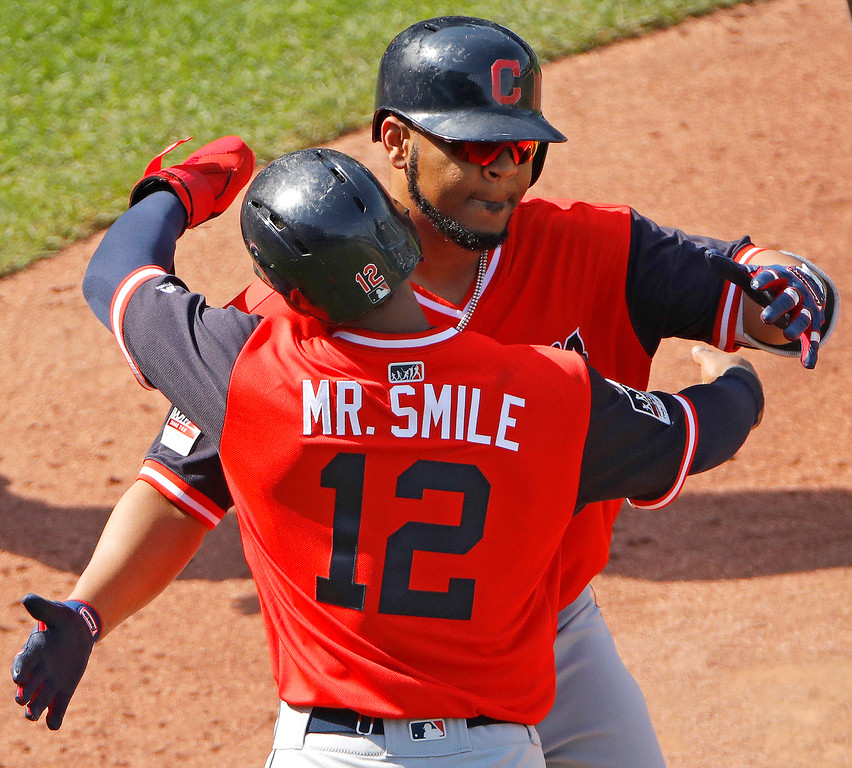 . Cleveland Indians\' Francisco Lindor (12) celebrates with Edwin Encarnacion after Encarnacion hit a two-run home run during the eighth inning of a baseball game against the Kansas City Royals Sunday, Aug. 26, 2018, in Kansas City, Mo. (AP Photo/Charlie Riedel)