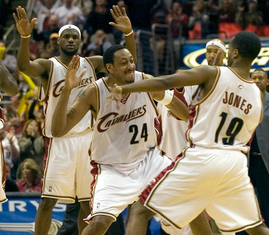 . PHOTO BY DAVID RICHARD Cleveland\'s Donyell Marshall, center, in congratulated by teammate Damon Jones after Marshall nailed a 3-pointer late in the fourth quarter last night against Boston. Celebrating in the background in LeBron James.