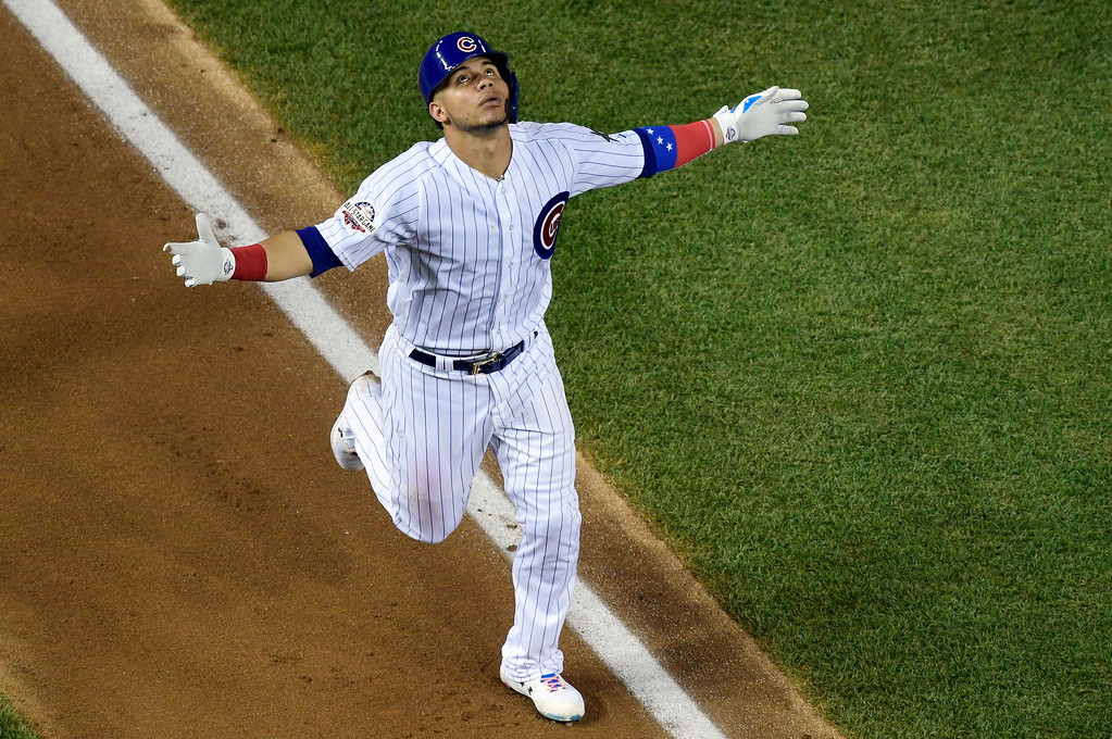 . Chicago Cubs catcher Willson Contreras (40) celebrates this third inning solo home run during the Major League Baseball All-star Game, Tuesday, July 17, 2018 in Washington. (AP Photo/Susan Walsh)