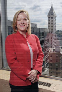 Stephanie Meeks, president of the National Trust for Historic Preservation, is pictured with the historic Smith Tower in the skyline background as seen from the Harborview Club in Seattle, Washington on April 8, 2015.