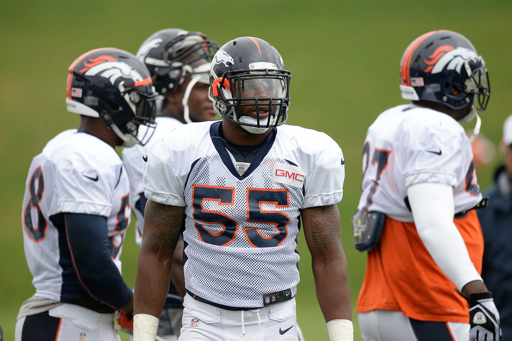. Denver Broncos outside linebacker Lerentee McCray (55) looks on during drills on day seven of the Denver Broncos 2014 training camp July 31, 2014 at Dove Valley. (Photo by John Leyba/The Denver Post)