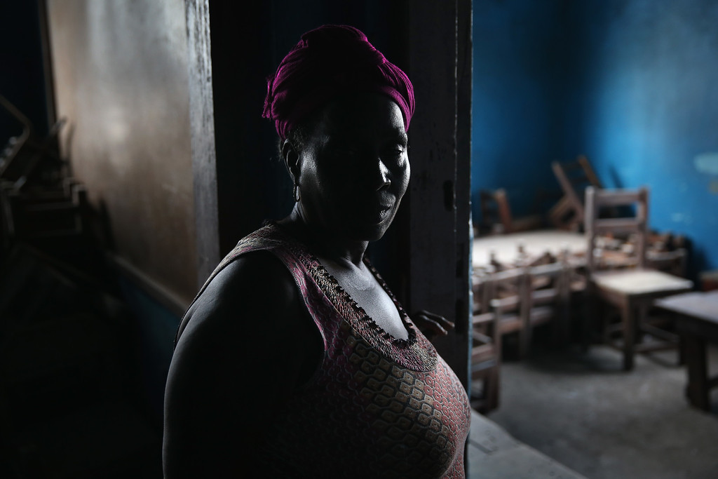 . A caretaker stands in a kindergarden on January 27, 2015 in Monrovia, Liberia. Although Liberian schools are supposed to reopen next Monday, February 2, many have not been cleaned nor have adequate supplies since they were closed last March due to the Ebola epidemic. Human contact and public gatherings were highly discrouaged to control the worst Ebola outbreak in history, which has now been reduced to single digits of Ebola cases nationwide.  (Photo by John Moore/Getty Images)