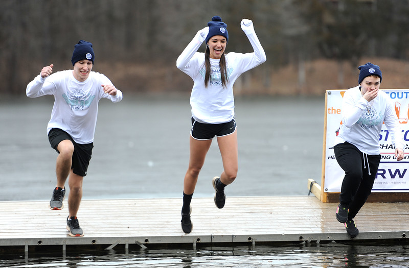1/19/2019 Mike Orazzi | Staff Jumpers from Cheshire Pizza during the 14th annual Sloper Plunge at Camp Sloper's pond Saturday in Southington.