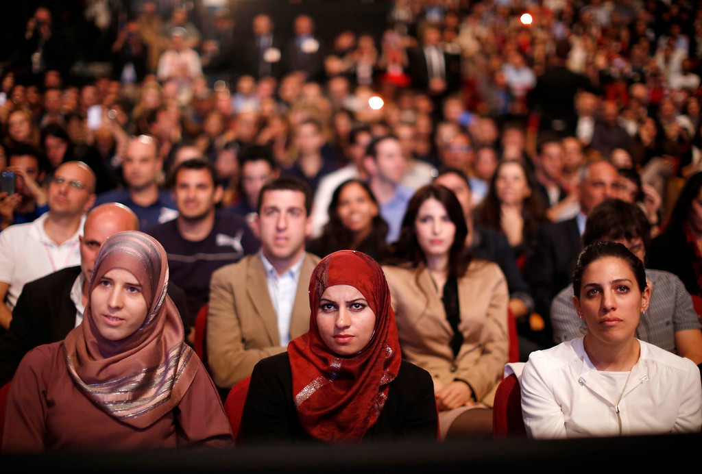 . Members of the audience listen as U.S. President Barack Obama delivers a speech on Mideast policy at the Jerusalem Convention Center, March 21, 2013.   REUTERS/Jason Reed