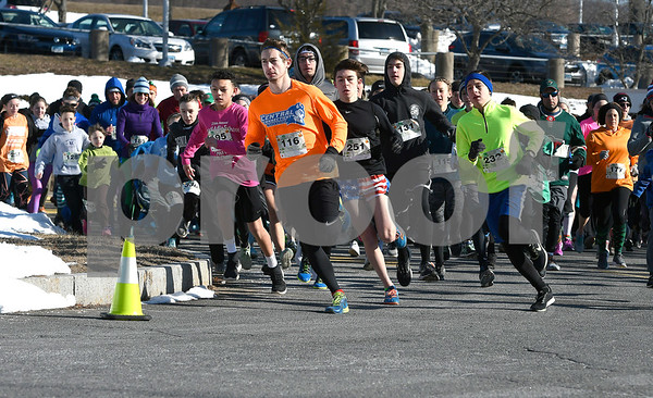 3/17/2018 Mike Orazzi | Staff Kenny Knox (116) leads the pack in the 2 mile run and walk during the 16th Annual Shamrock Run and Walk held at the Chippens Hill Middle School Saturday morning.