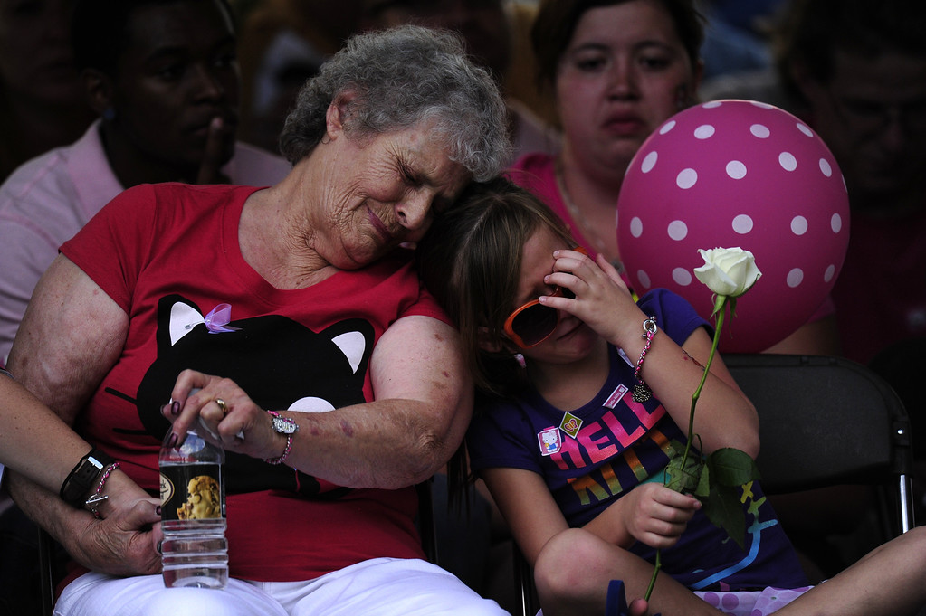 . Marlene Knobbe, grandmother of Micayla Medek killed in the movie theater shooting, consoles family member Rachel Vigil at a community vigil at the Aurora Municipal Center on Sunday, July 22, 2012. AAron Ontiveroz, The Denver Post