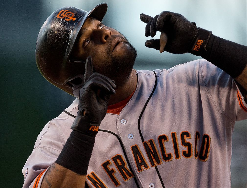 . Pablo Sandoval #48 of the San Francisco Giants points to the sky to celebrate his solo home run during the first inning against the Colorado Rockies at Coors Field on August 27, 2013 in Denver, Colorado.  (Photo by Justin Edmonds/Getty Images)
