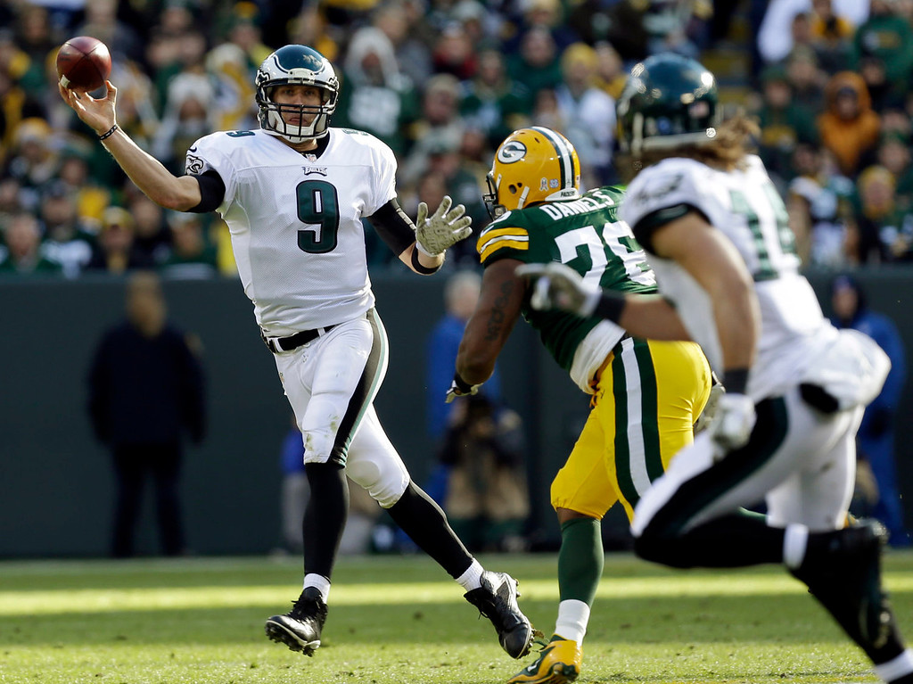 . Philadelphia Eagles quarterback Nick Foles throws during the first half of an NFL football game against the Green Bay Packers Sunday, Nov. 10, 2013, in Green Bay, Wis. (AP Photo/Mike Roemer)