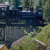 Engine Number 9 crossing the bridge at the mining camp headed to Silver Plume.