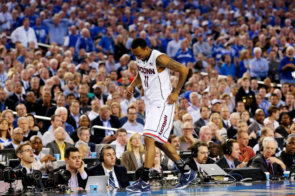 . ARLINGTON, TX - APRIL 07:  Ryan Boatright #11 of the Connecticut Huskies reacts after hurting his ankle during the NCAA Men\'s Final Four Championship against the Kentucky Wildcats at AT&T Stadium on April 7, 2014 in Arlington, Texas.  (Photo by Ronald Martinez/Getty Images)
